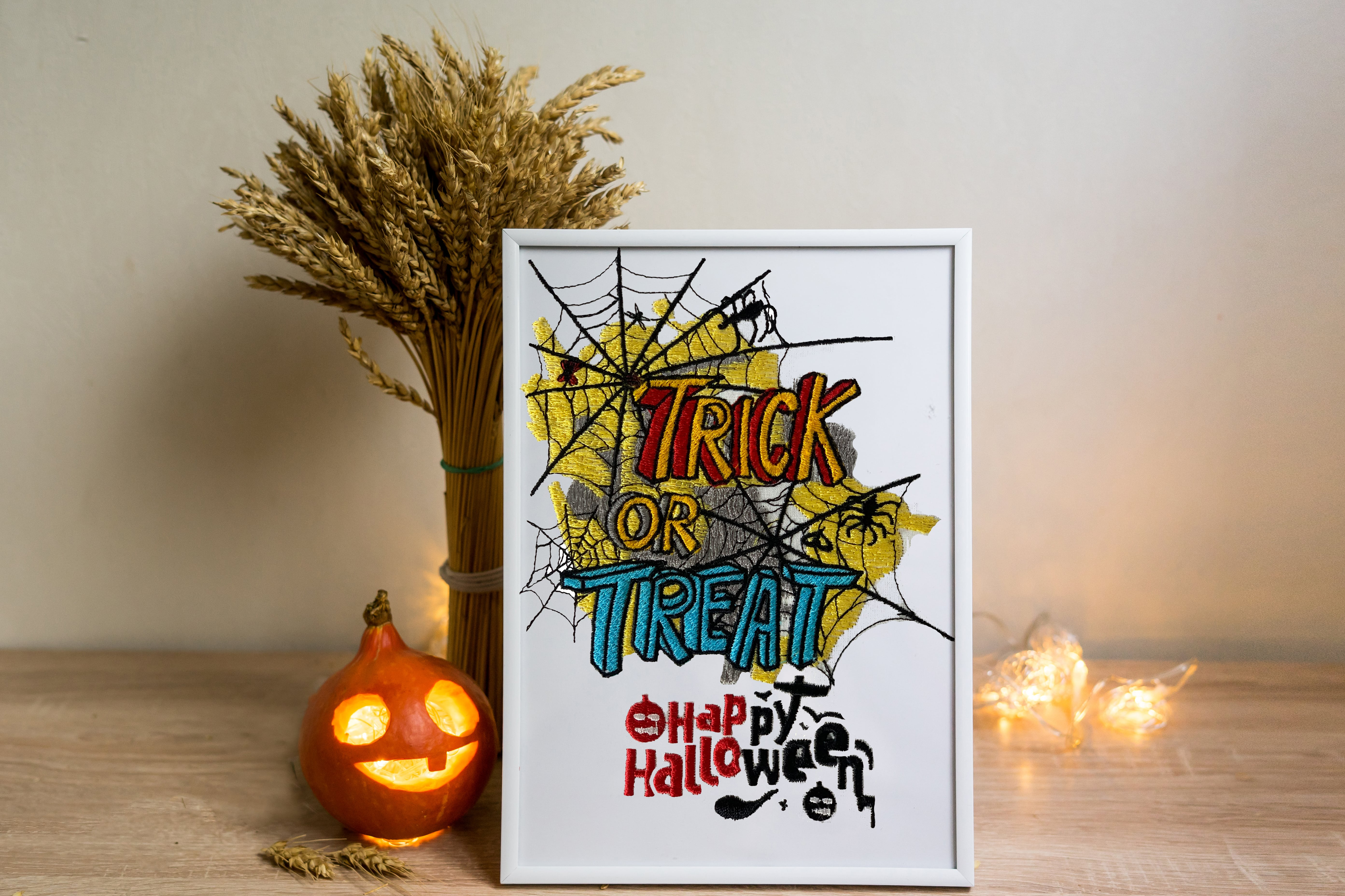 Trick Treat Text Halloween Poster Embroidery design with spider net background